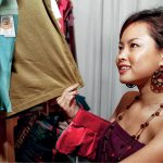 Woman looking at fabric, Tanatex is expert in waterproof fabric