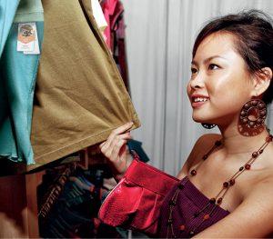 Woman looking at fabric,